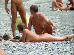 Threesome nude action on the beach