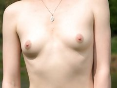 Small tits exposed outdoors