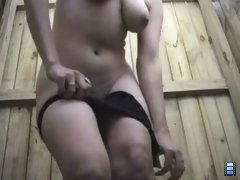 Cute brunette slut with nice looking big tits, taking off her black shorts.
